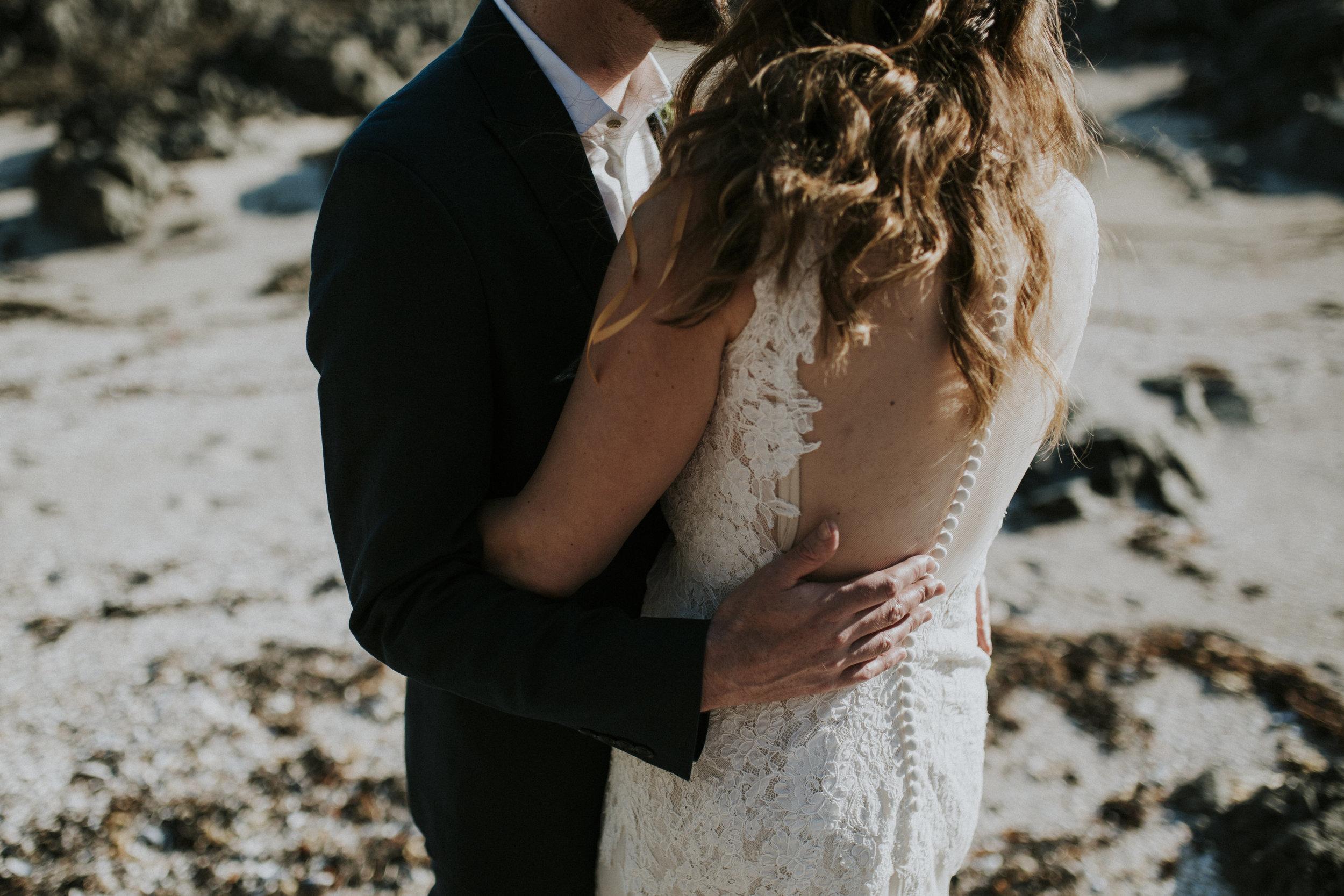 couple at sunset embracing beach wedding wickaninnish inn tofino