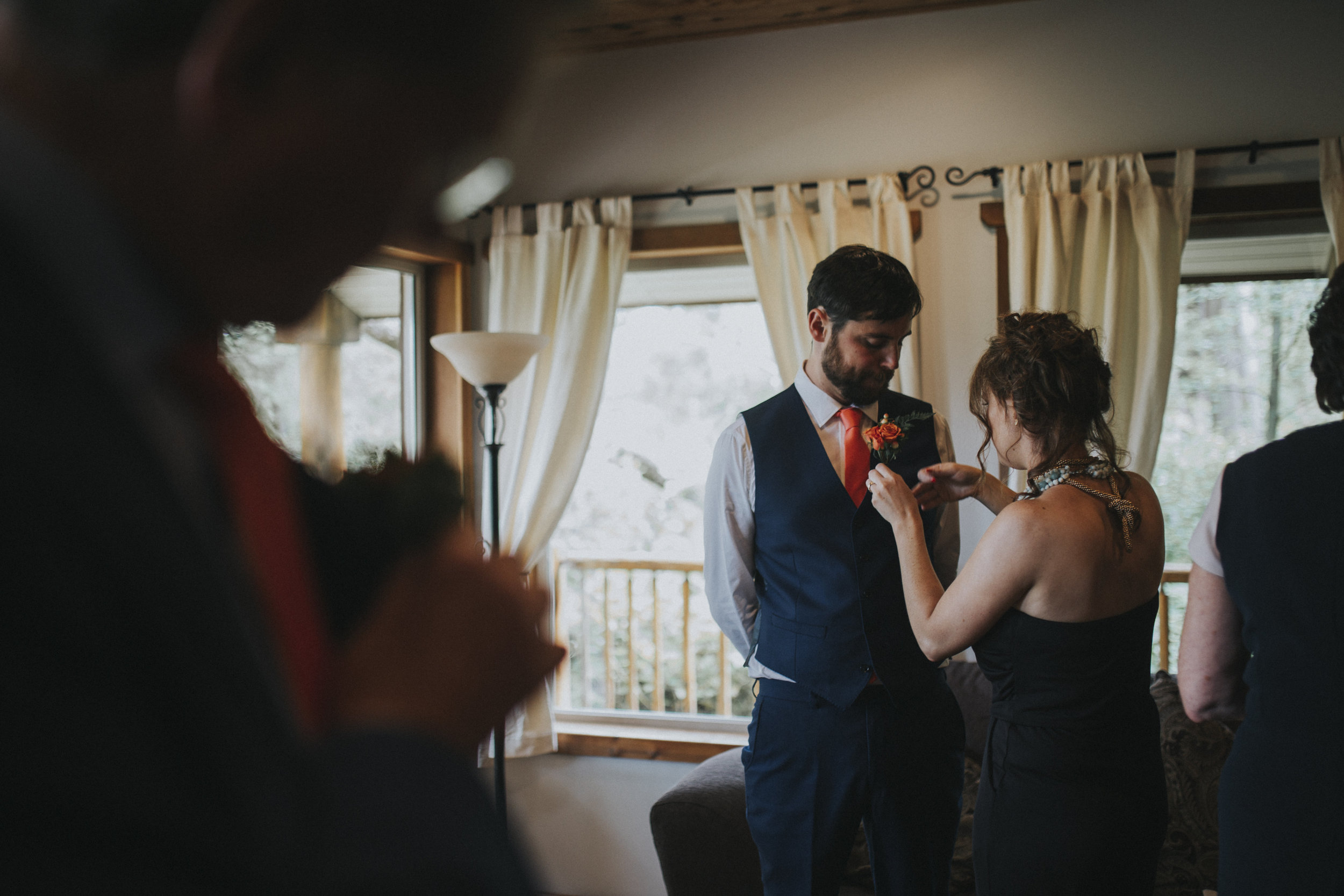 Groom gets ready with family tofino wedding photographer