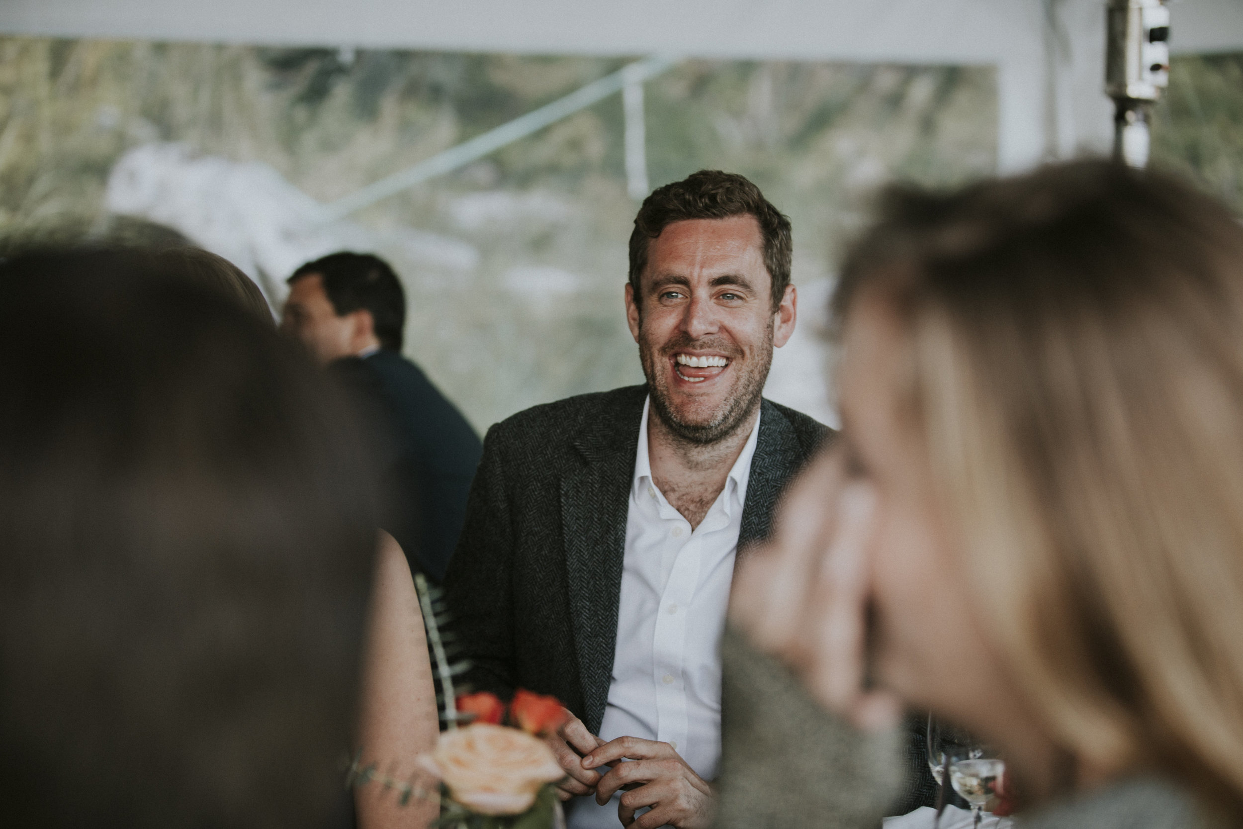 wedding guests laughing at reception wickaninnish inn beach wedding