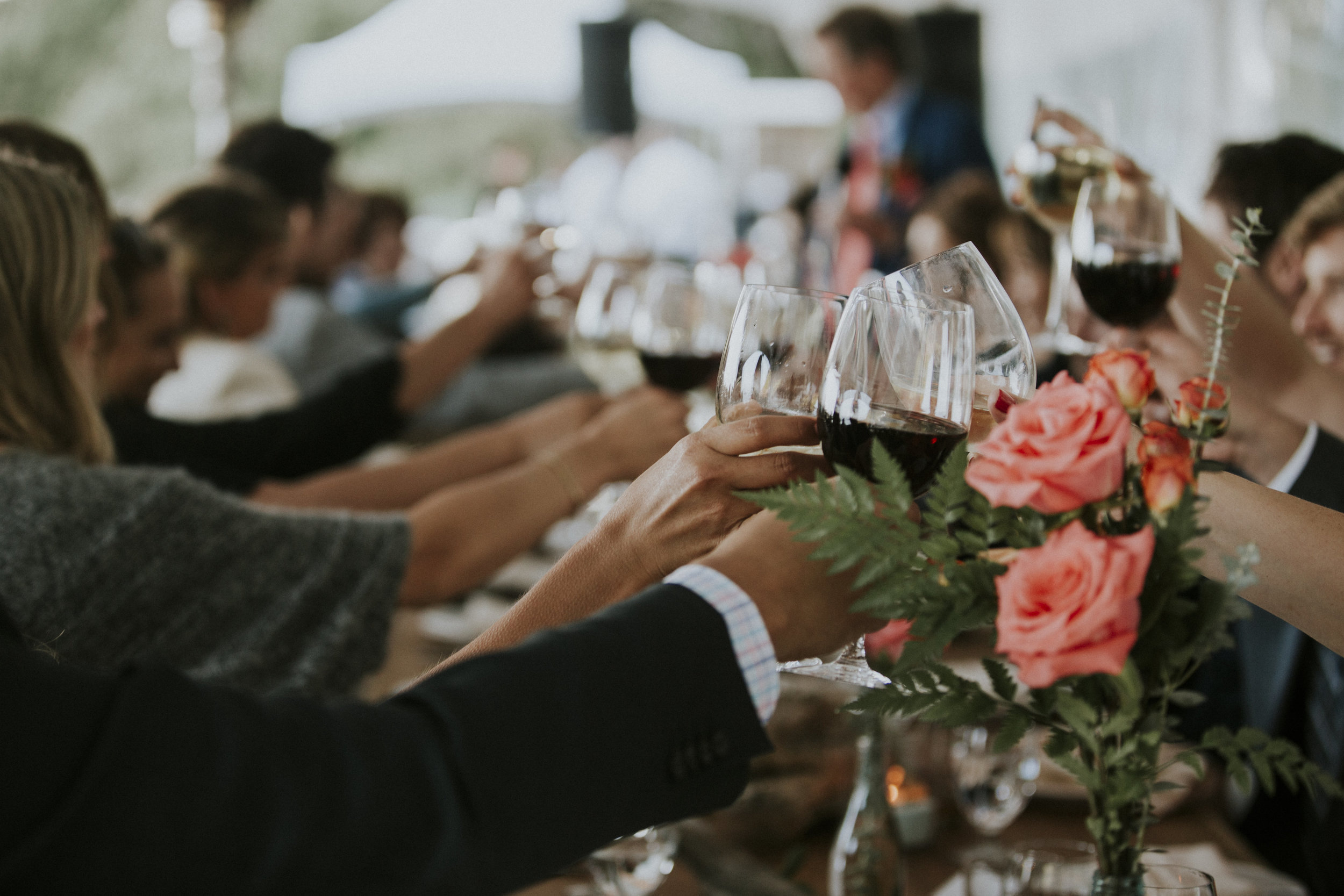 guests cheers to newly married couple at wickaninnish inn beach wedding