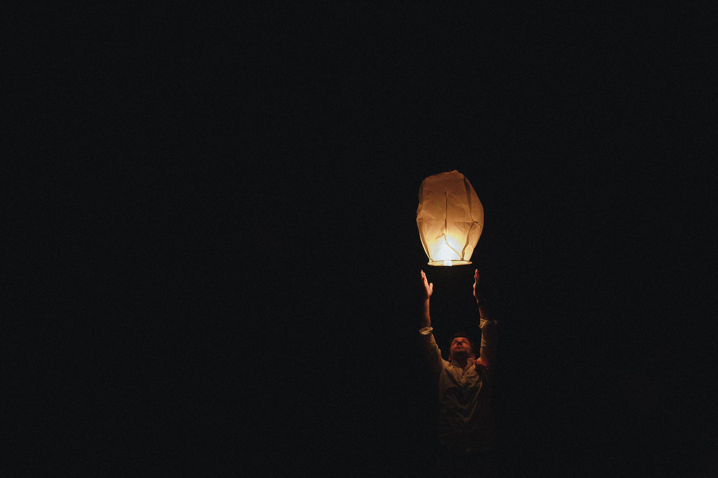 paper lanter and man on beach at wickaninnish inn tofino wedding