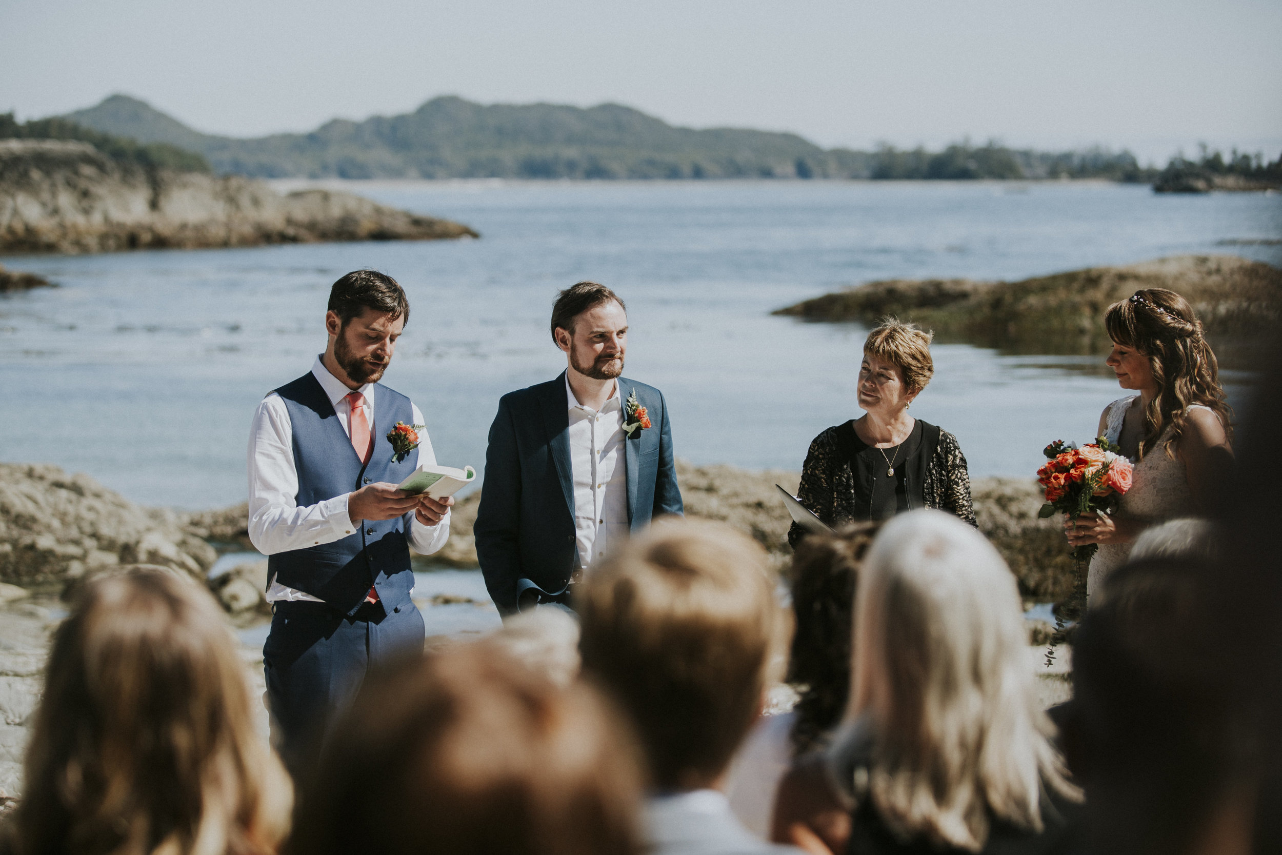 grooman reads poem at wedding ceremony on beach in tofino
