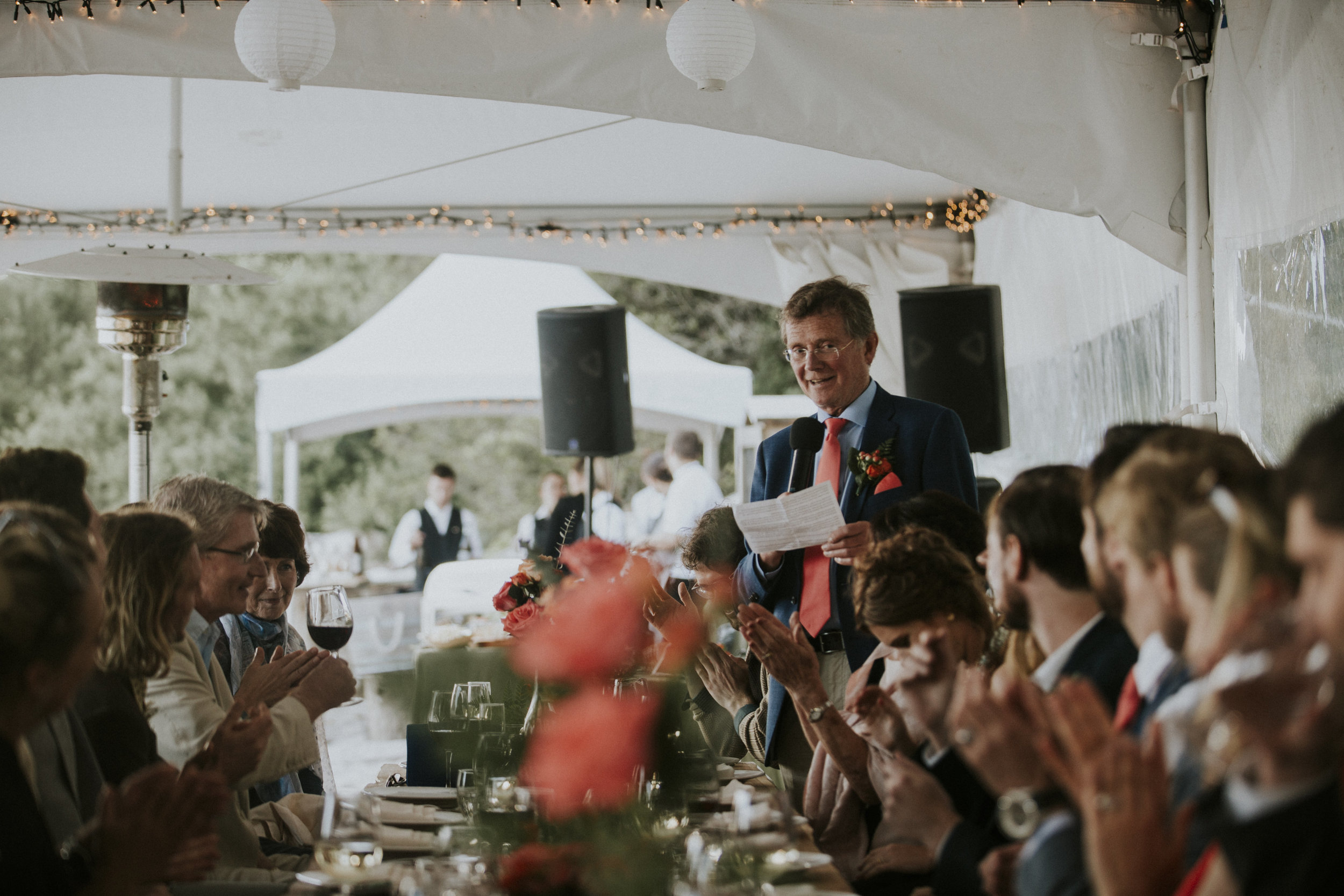 father of groom speaks at reception beach wedding wickaninnish inn