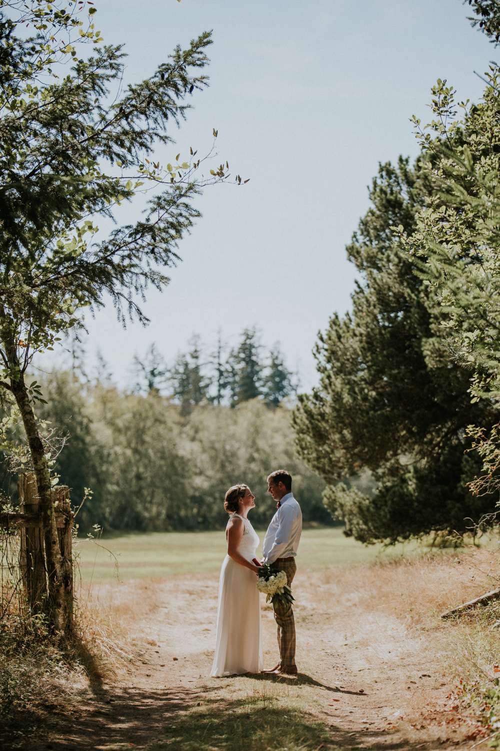 About to be wed Bride and Groom holding hands King Francis Park Forest wedding Vancouver Island