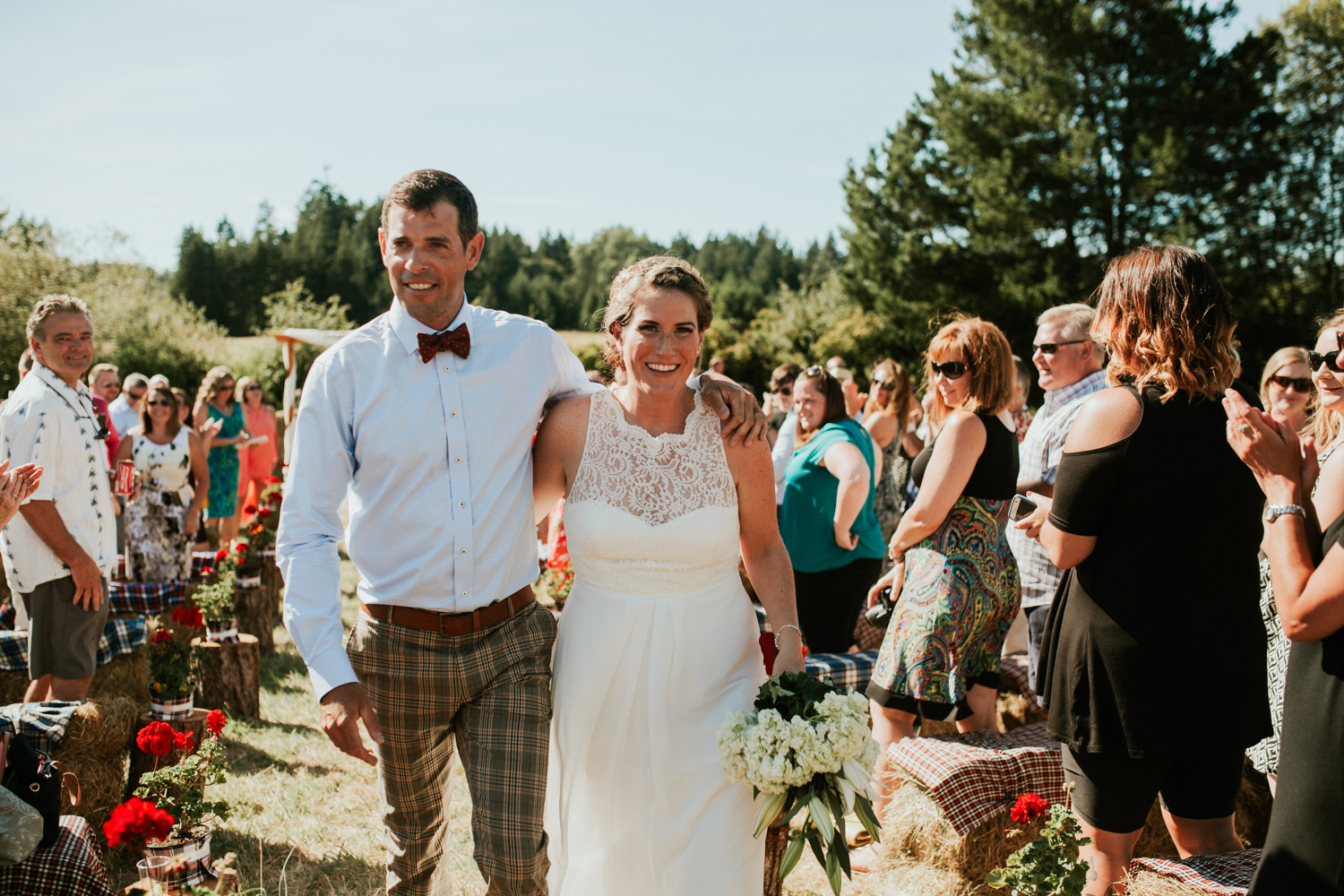 Newly wed Bride and Groom walking King Francis Park Forest Wedding Vancouver Island