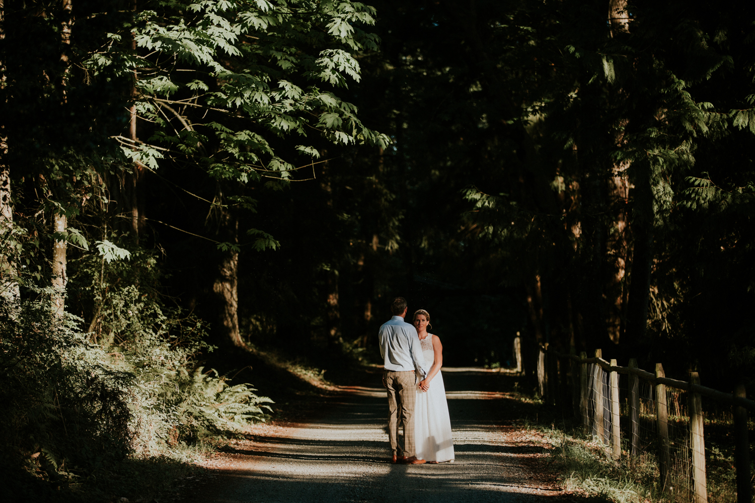 The newly wed Bride and Groom strolling King Francis Park Forest wedding ceremony Vancouver Island