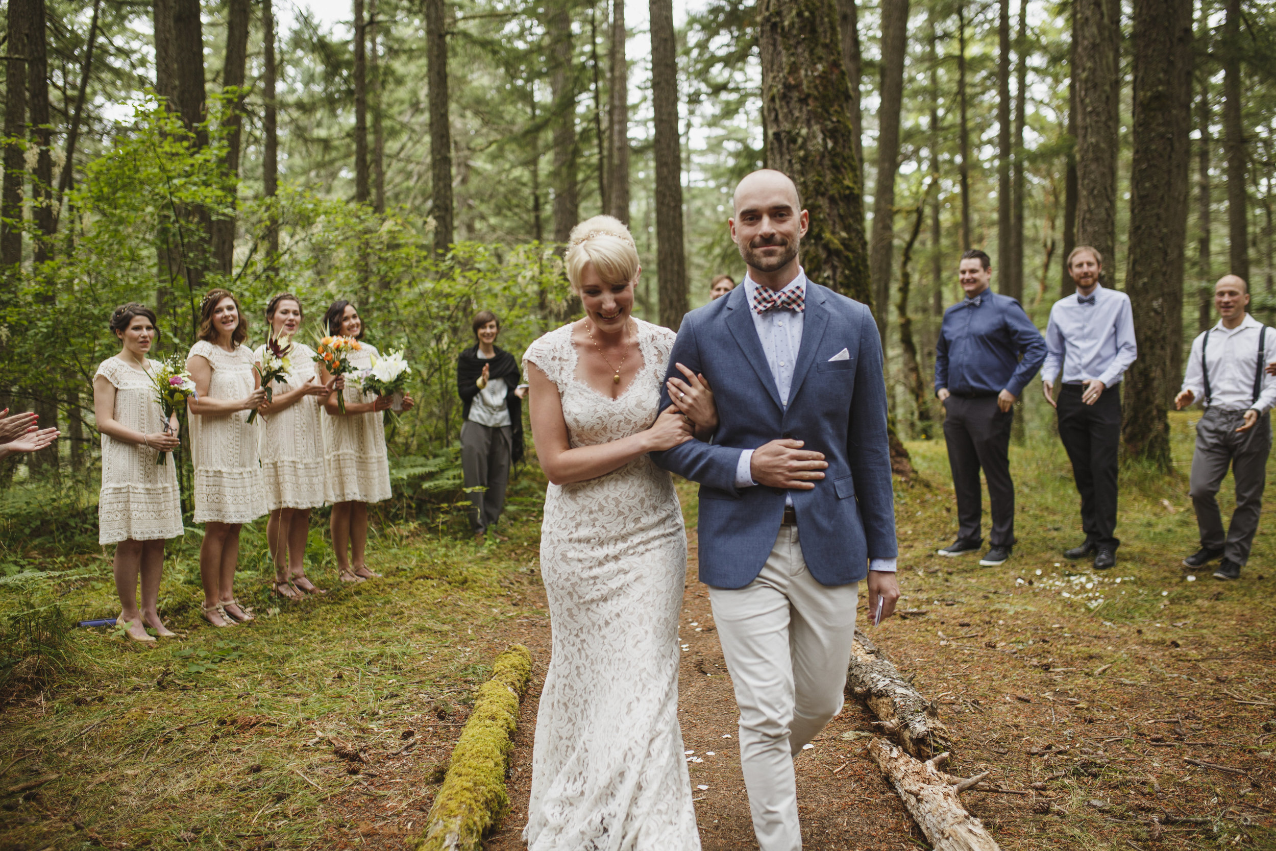 Newly wed couple walking along the isle Forest wedding at King Francis Park Vancouver Island