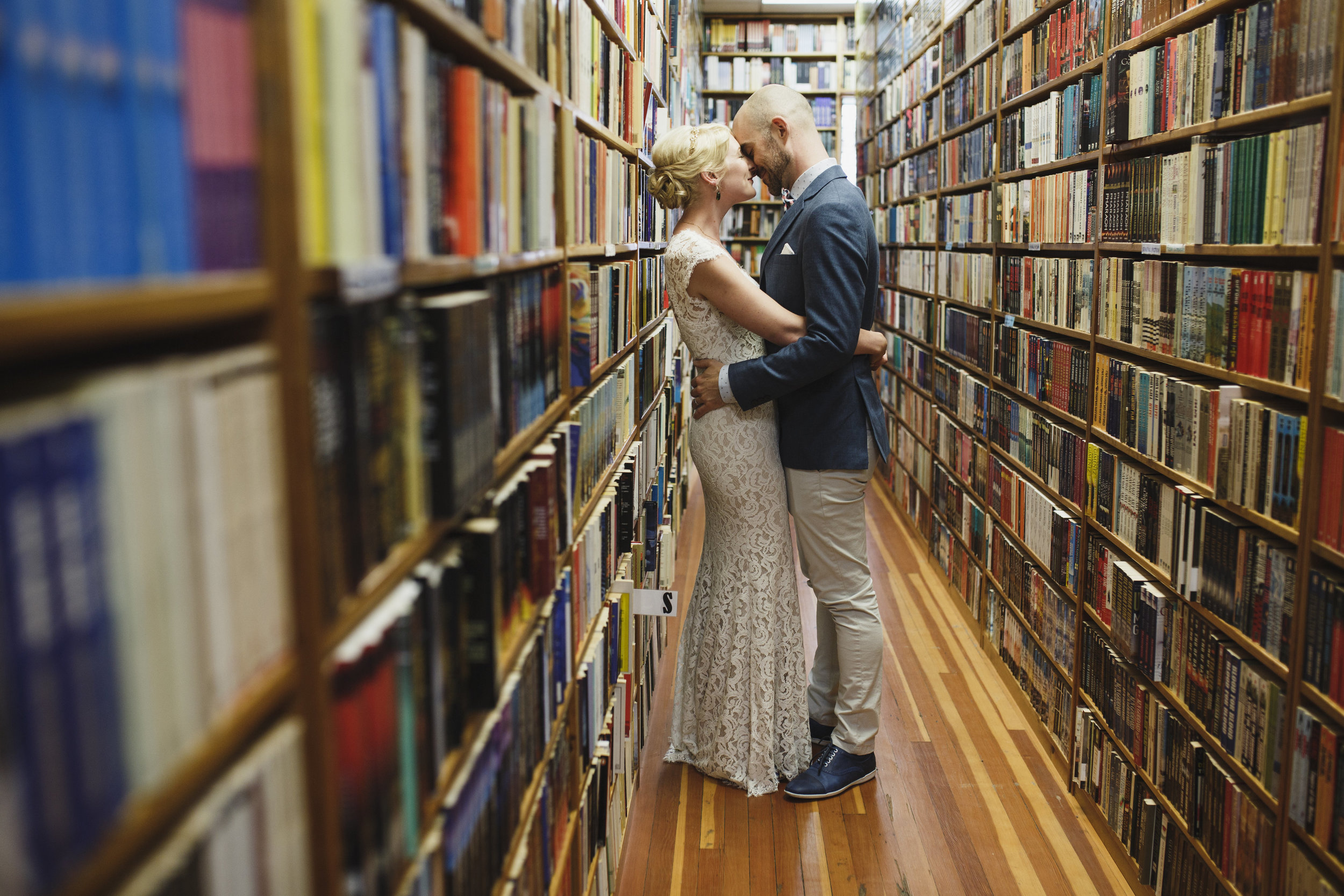 Bride and Groom kissing at a bookstore Wedding at the Guild Vancouver Island