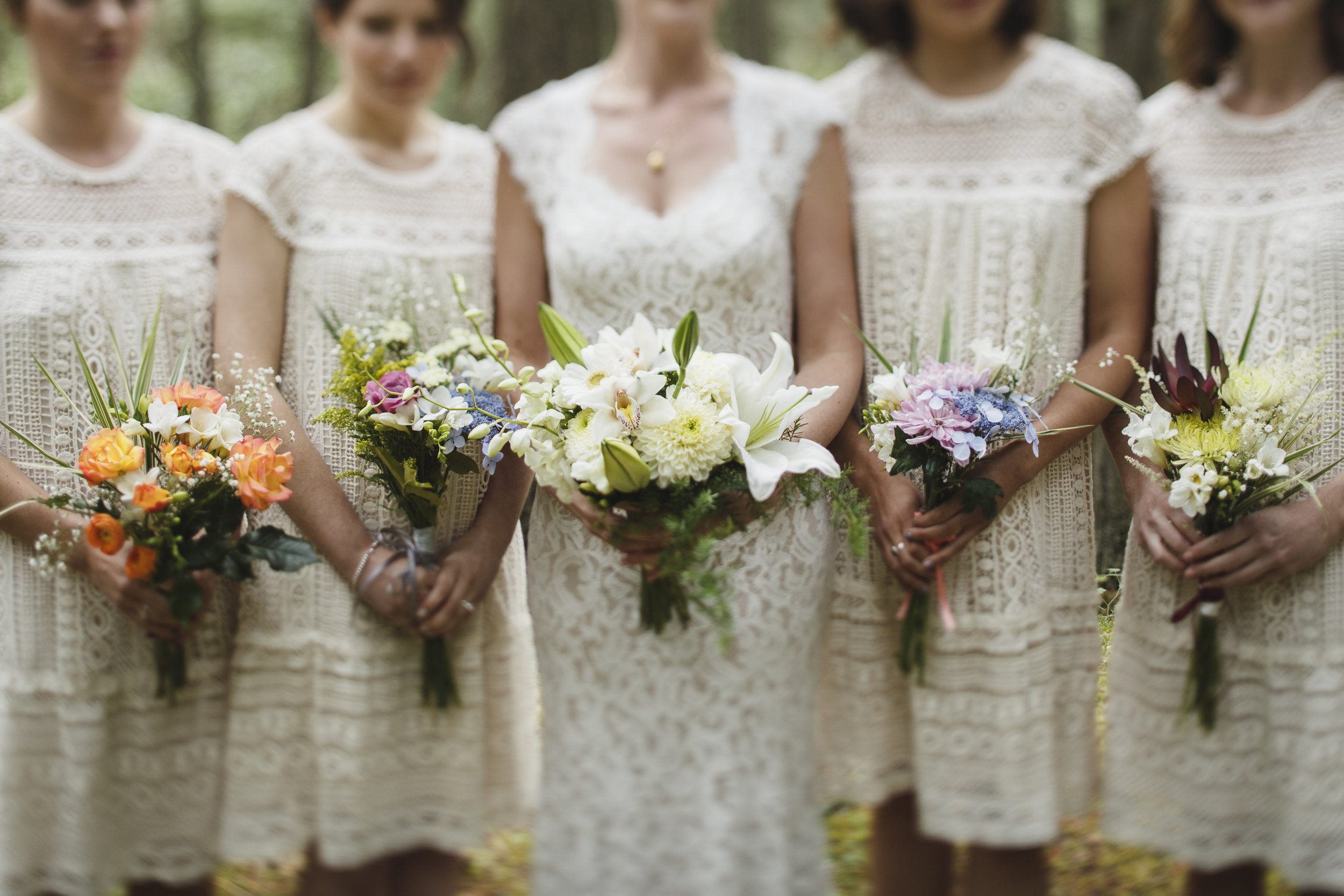 The Bride and her bridesmaid holding flowers Forest wedding at King Francis Park Vancouver Island