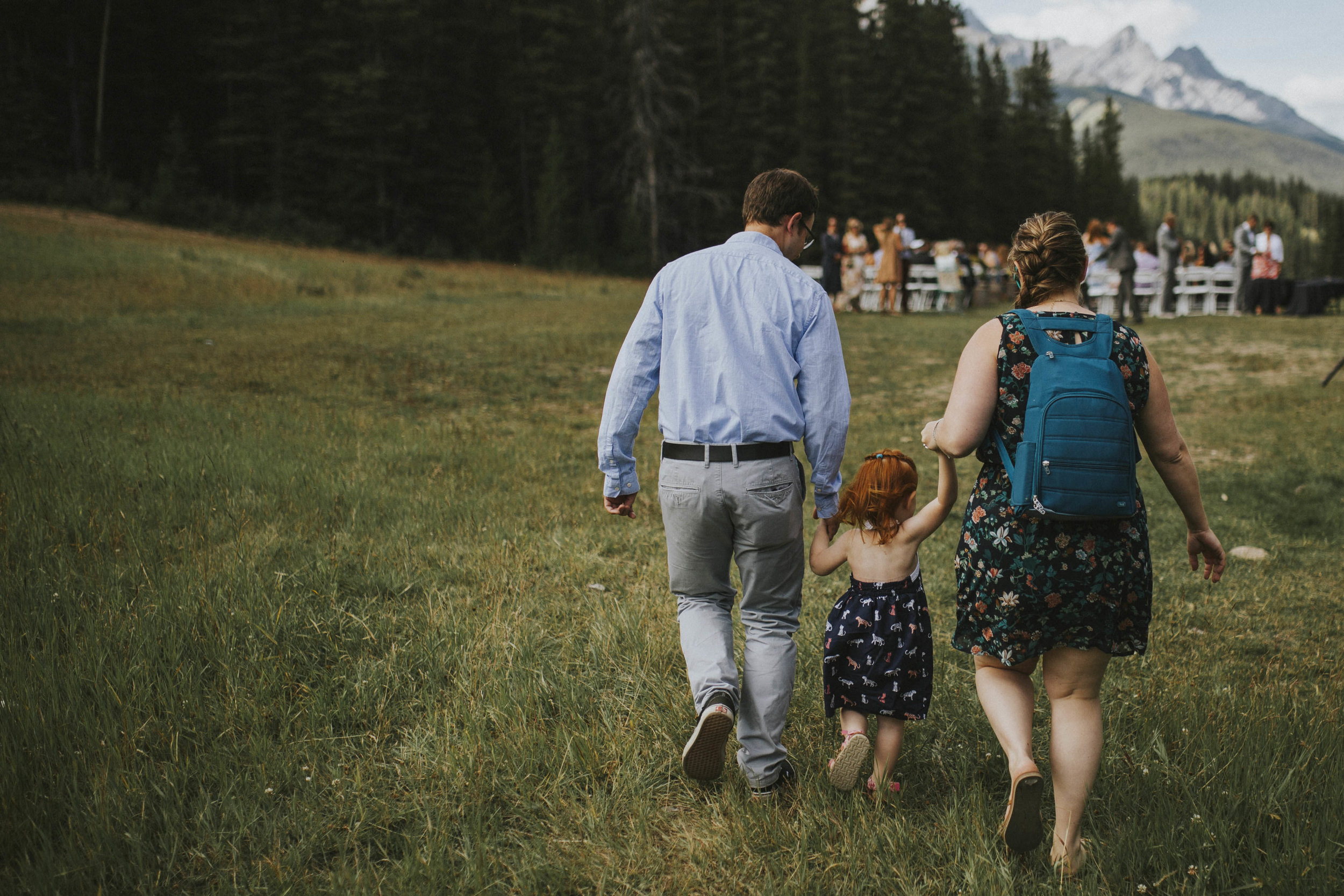 guests walk towards ceremony site mt norquay wedding
