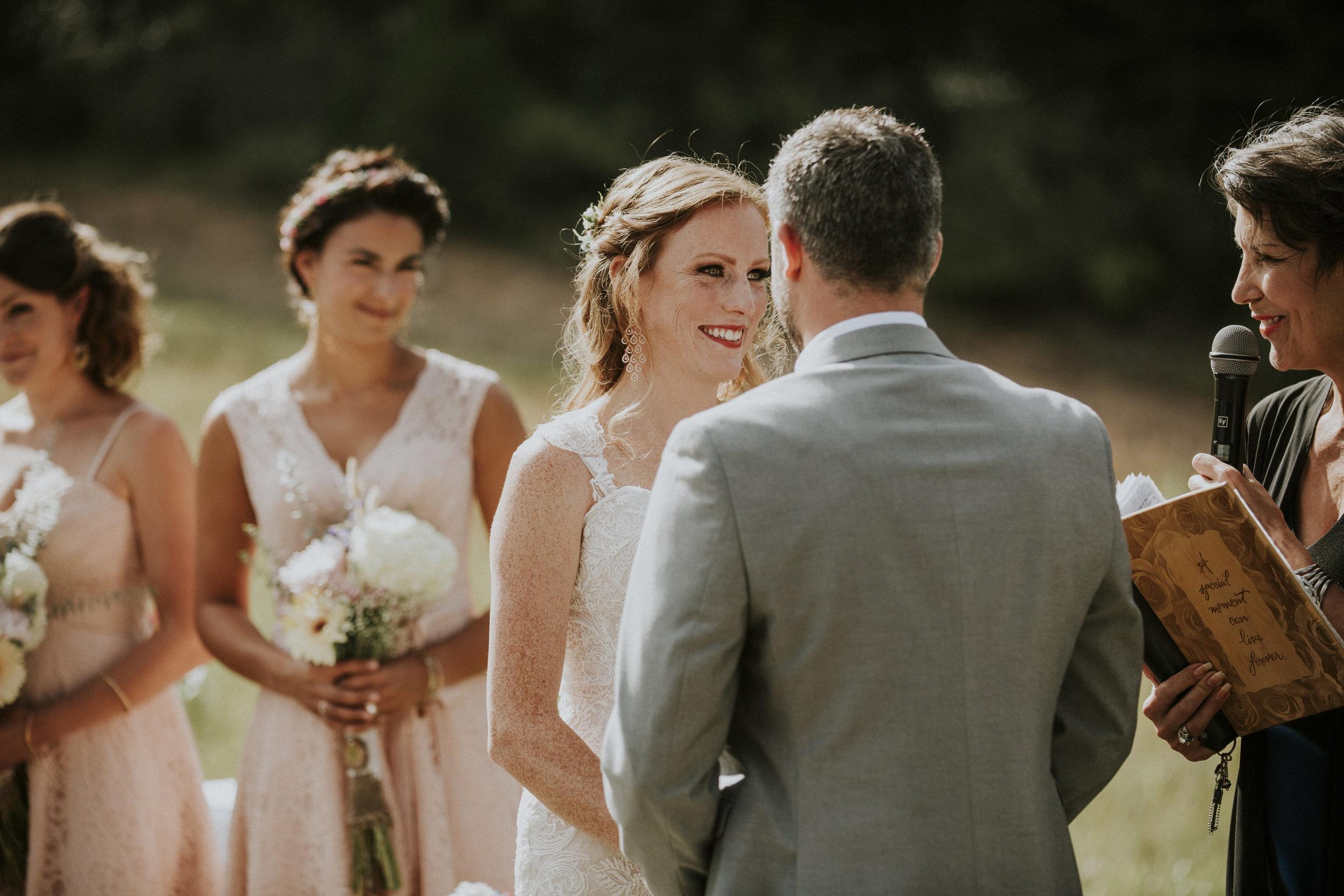 bride smiles at groom ceremony mountain banff