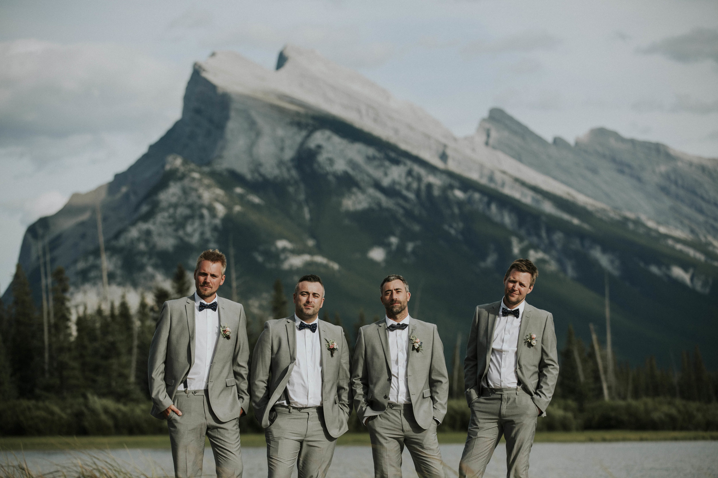 groomsmen pose in from of banff mountain