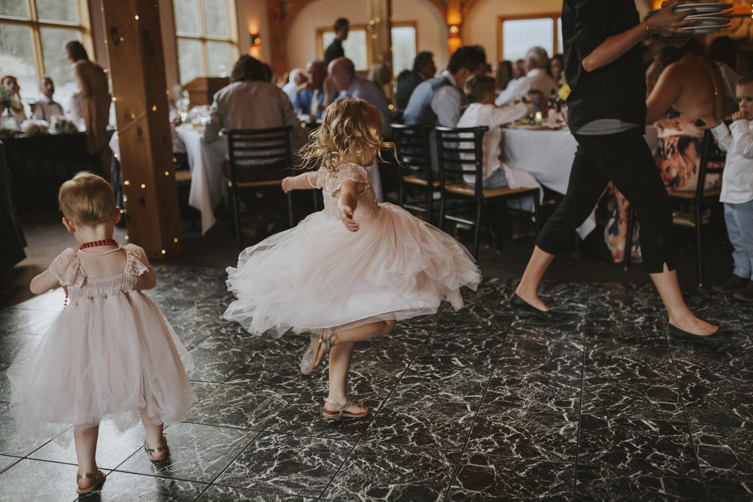 flower girl dances at reception mt norquay banff