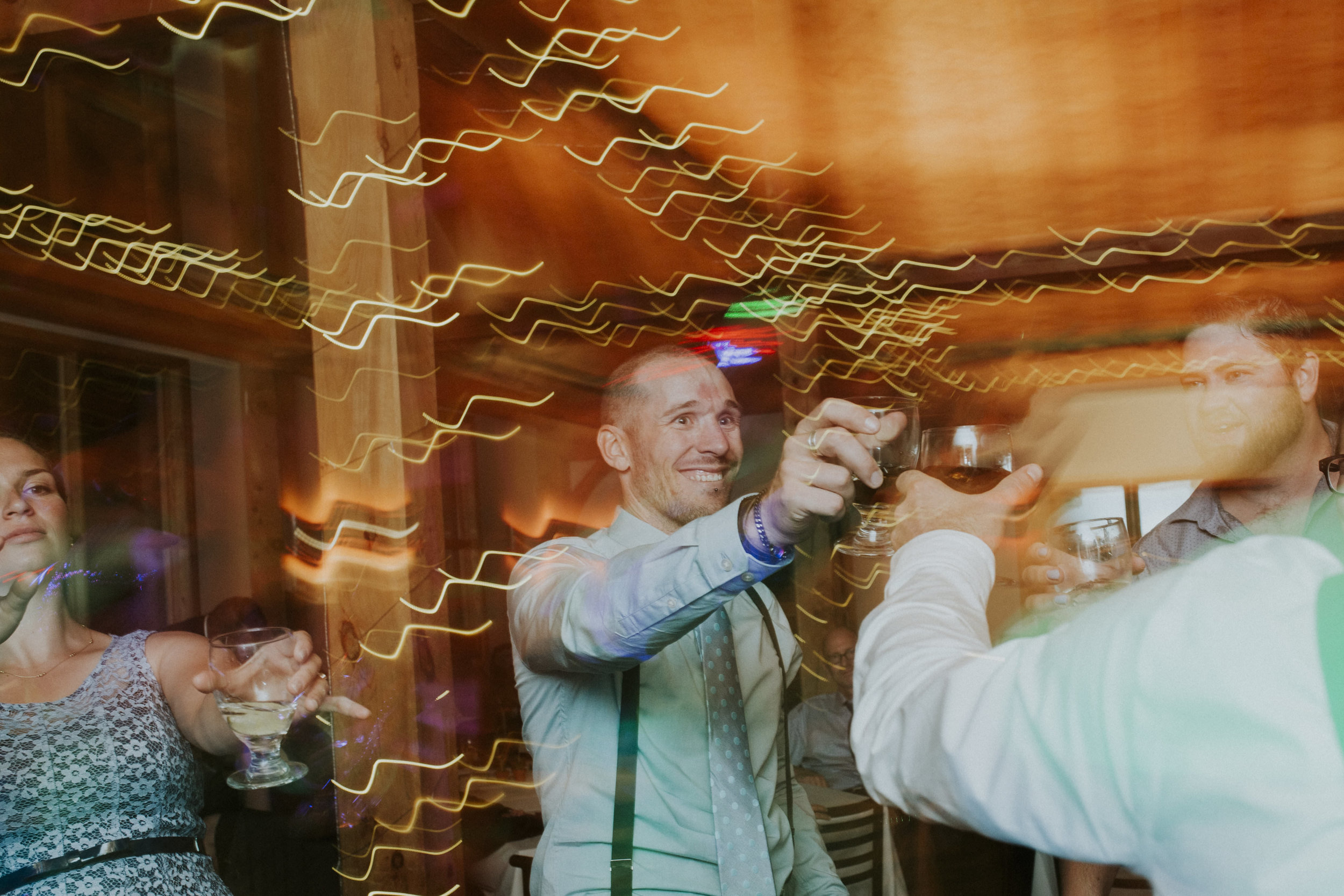 guests cheers at wedding reception mt norquay banff