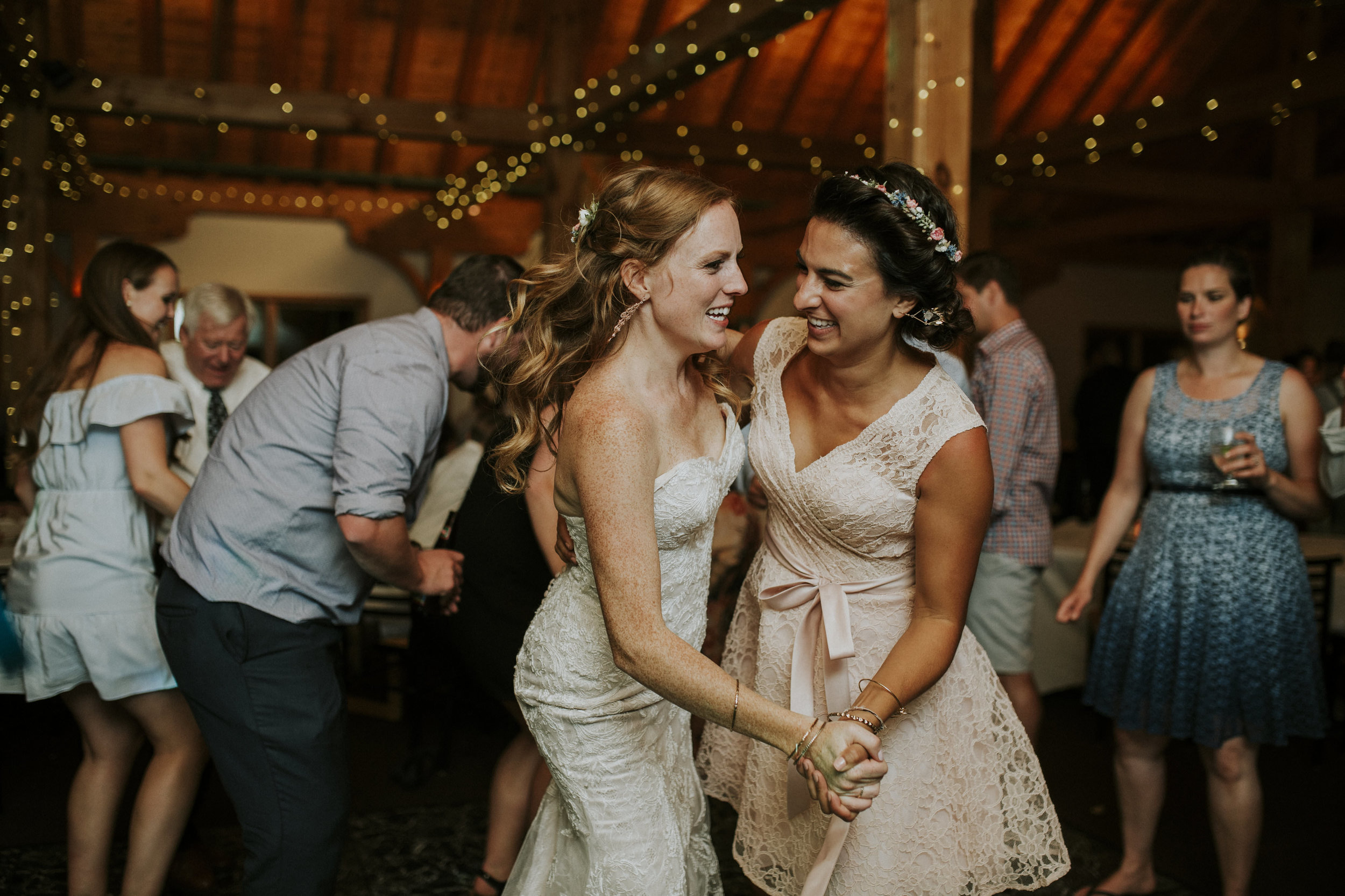 bride and friend dance at mt norquay banff wedding