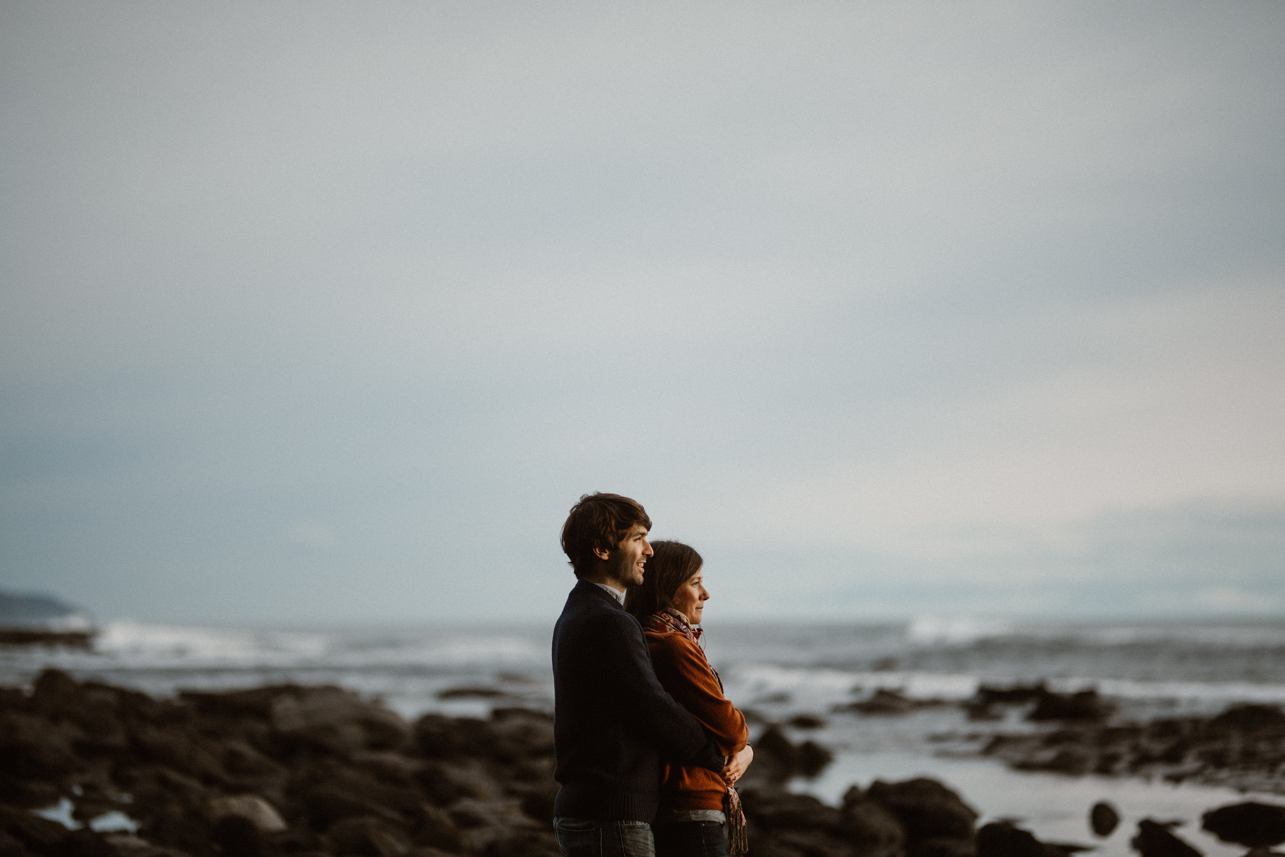 Couple's embrace Botanical Beach, Juan de Fuca, Vancouver Island Engagement