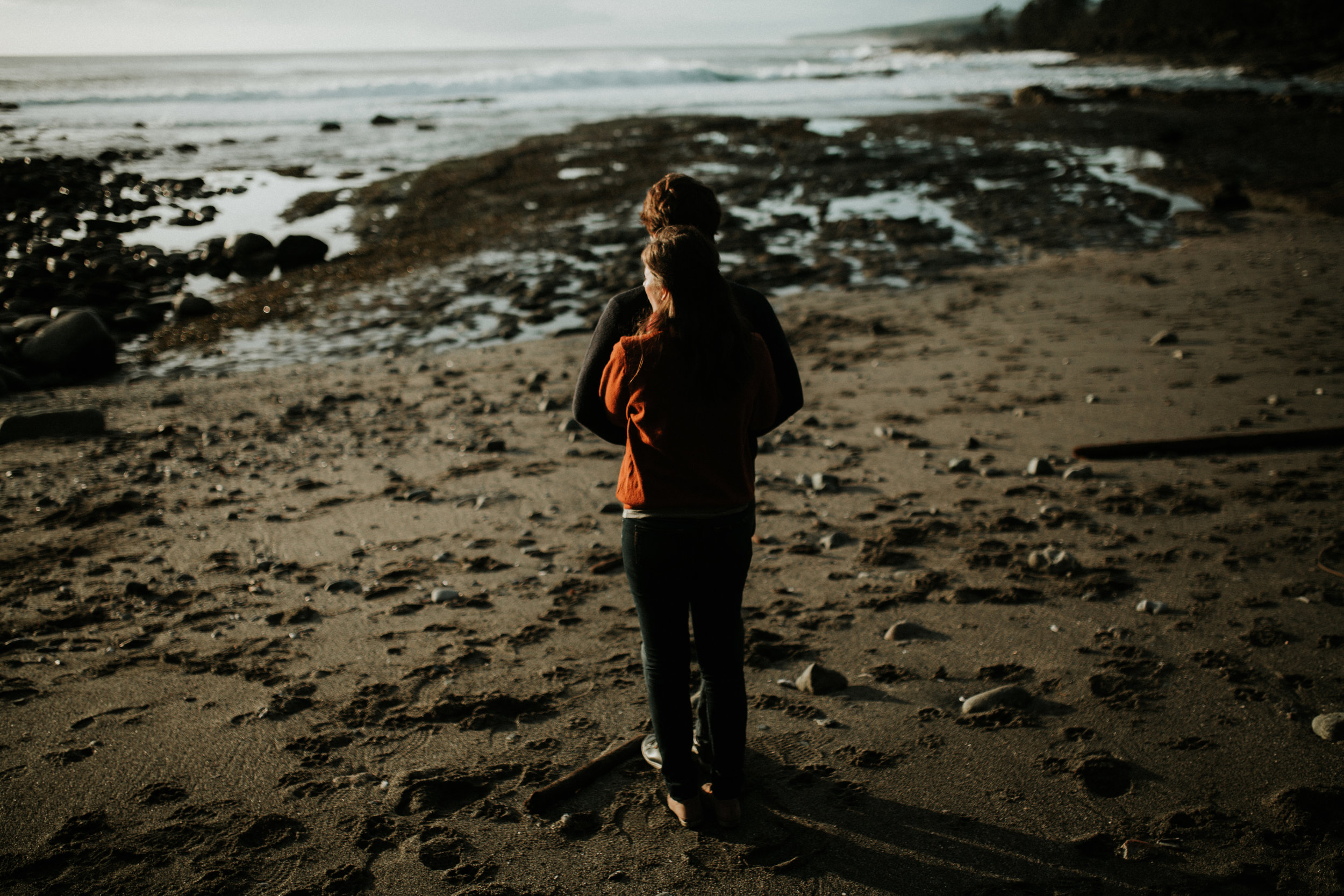 Couple hugging beach Engagement Botanical Beach, Juan de Fuca,