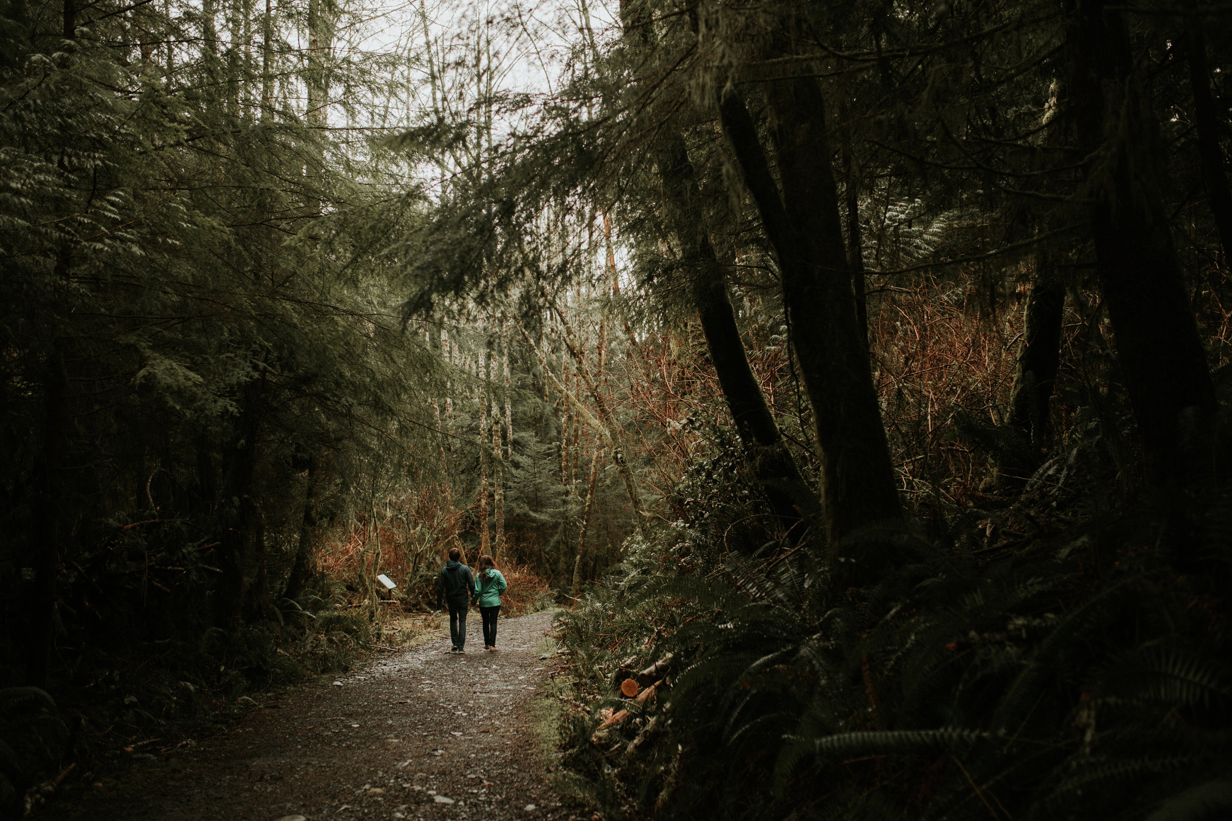 Couple walking in the forest path Beach Engagement Botanical Beach Juan de Fuca