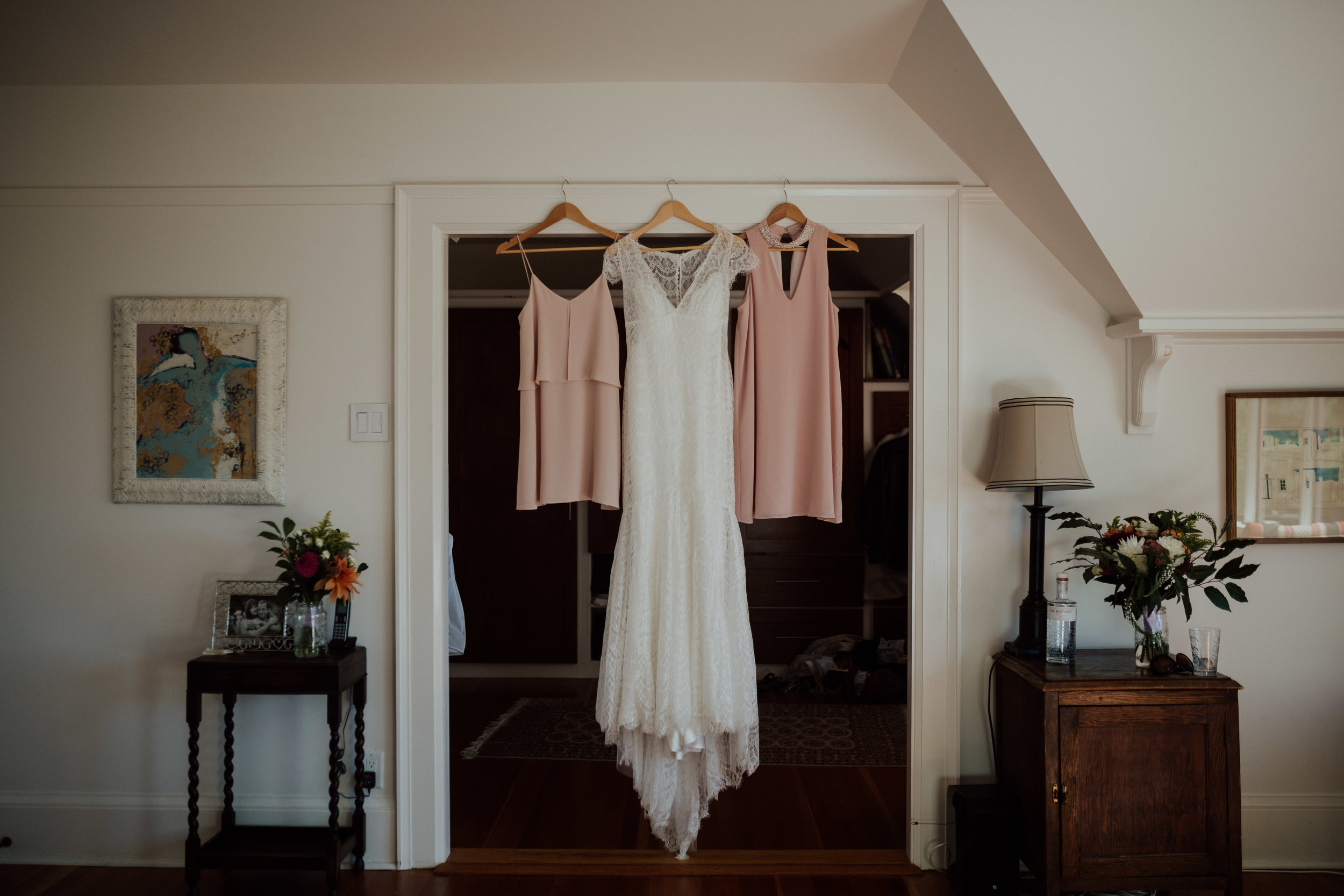 wedding dress hangs in getting ready room, vancouver island wedding