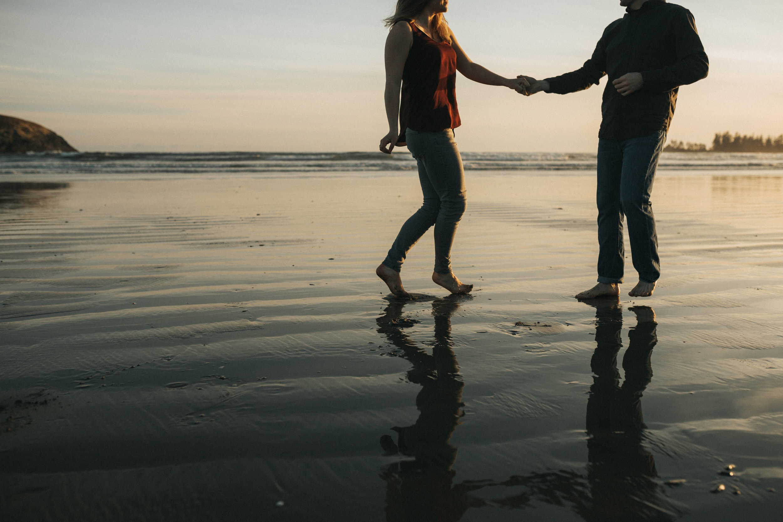 Couple dancing on the beach at Long Beach in Tofino, on Vancouver Island.