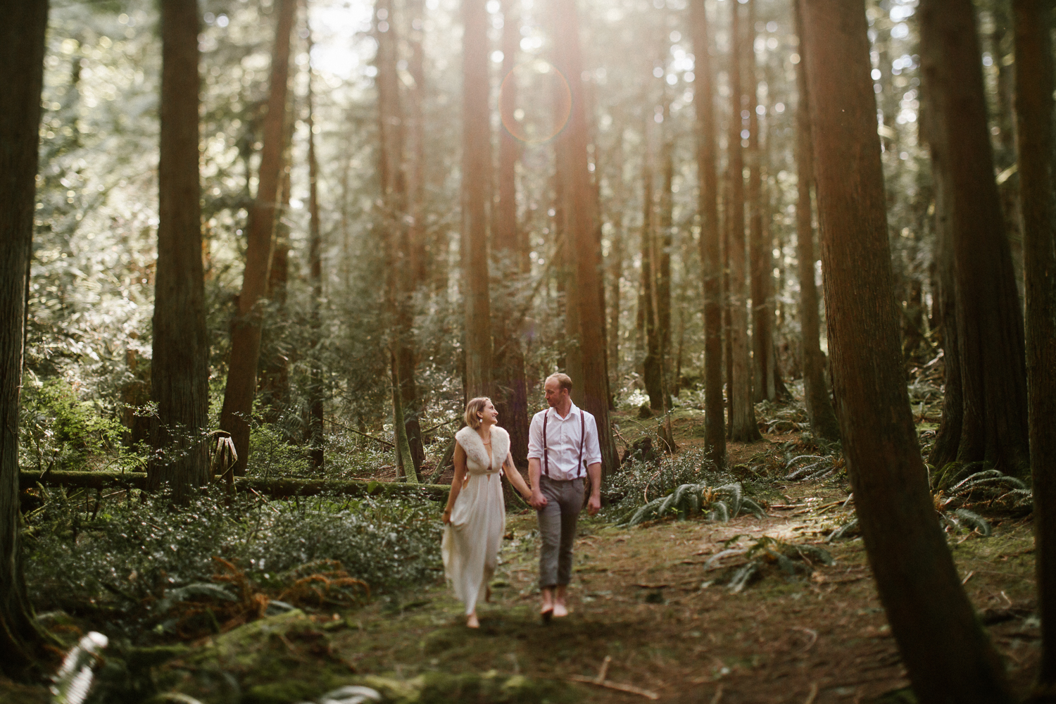 Couple walking in their forest kingdom Fairytale Engagement Victoria BC