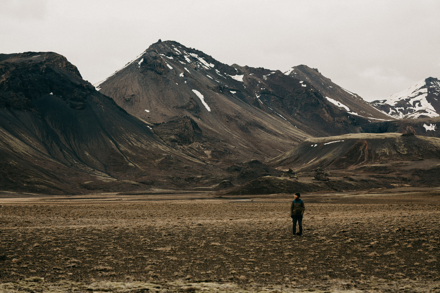 man in mountain valley iceland