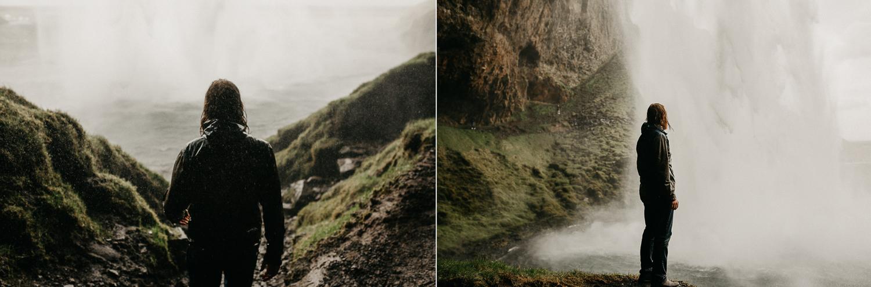 man behind Seljalandsfoss waterfall