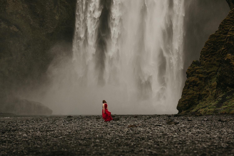 woman in red dress Seljalandsfoss iceland