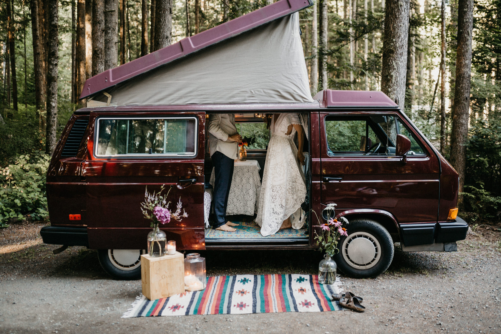 Couple gets dressed for wedding in VW Westie Elopement Sombrio Beach Vancouver Island