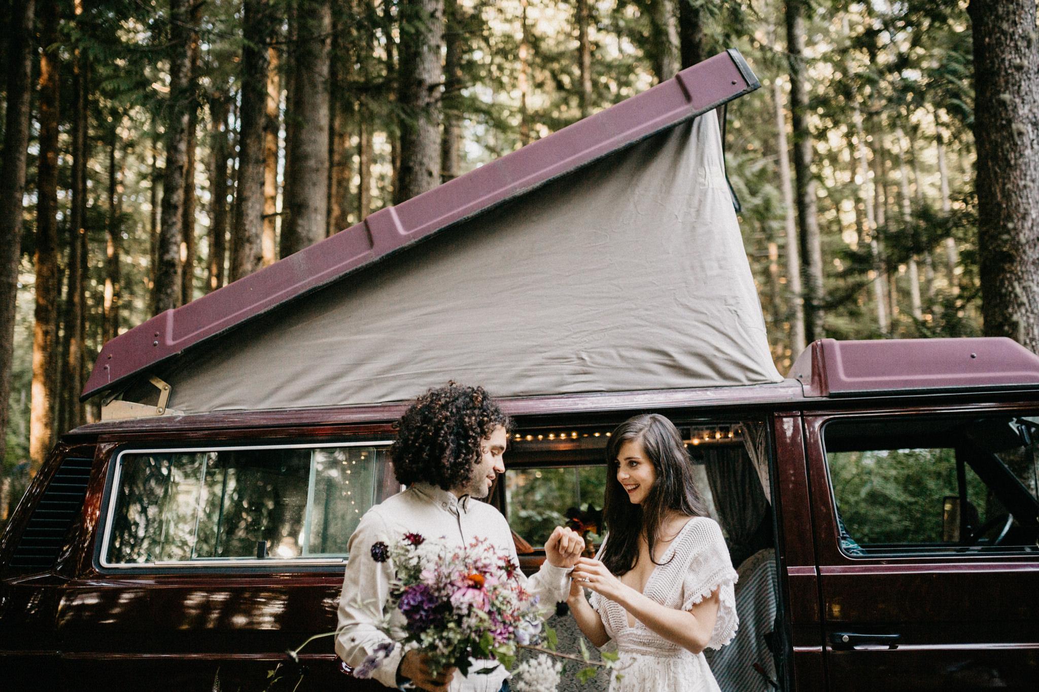 bride and groom holding bouquet VW Westie Elopement Sombrio Beach Vancouver Island
