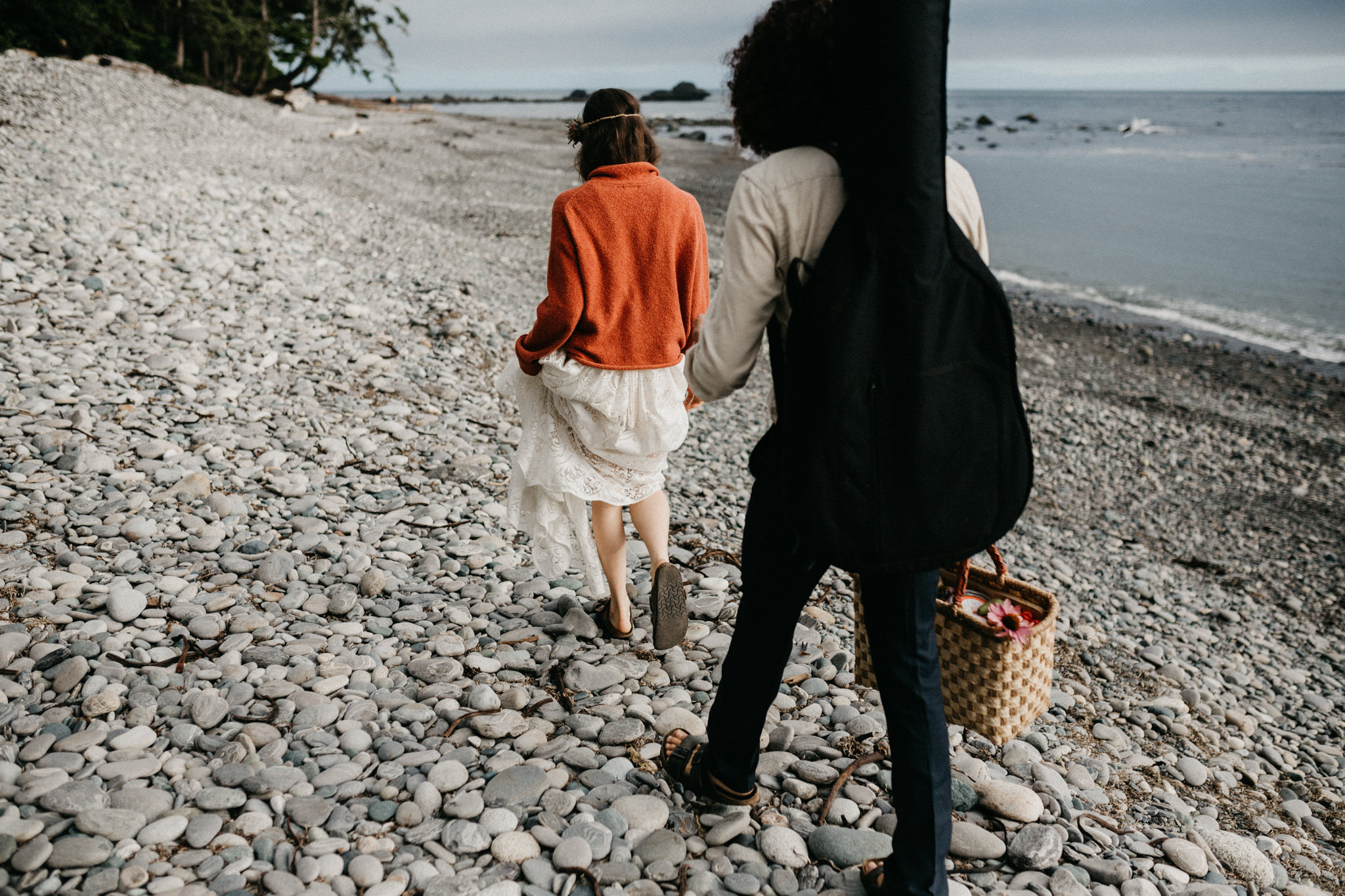 bride and groom walk the beach Sombrio Beach Vancouver Island