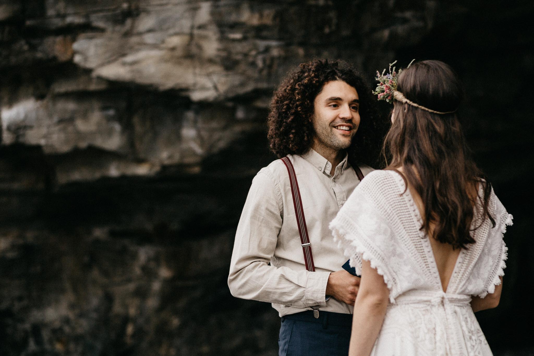 bride and groom exchange vows on beach Elopement Sombrio Beach Vancouver Island