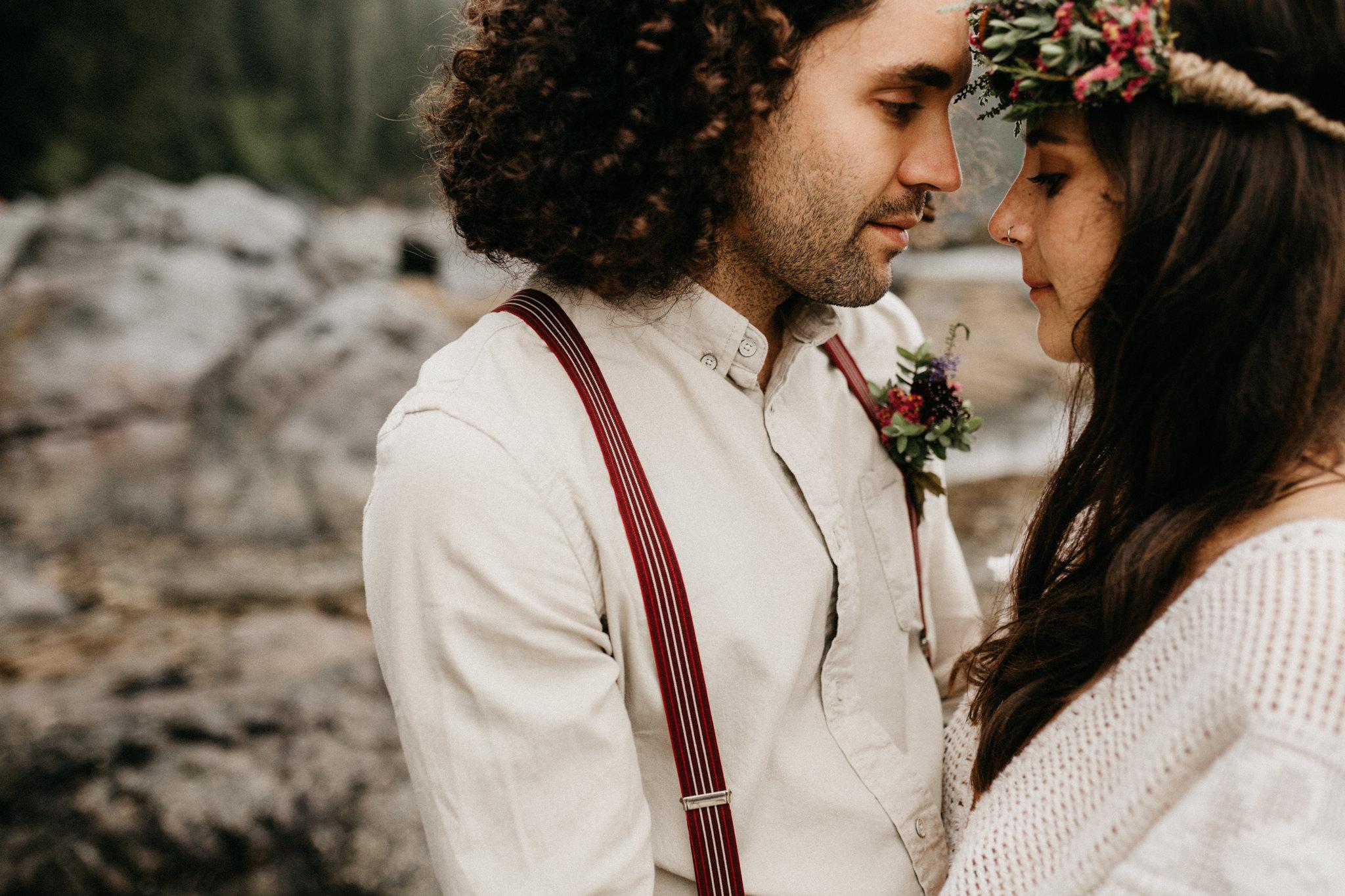 Groom looks at his Bride Sombrio Beach Vancouver Island