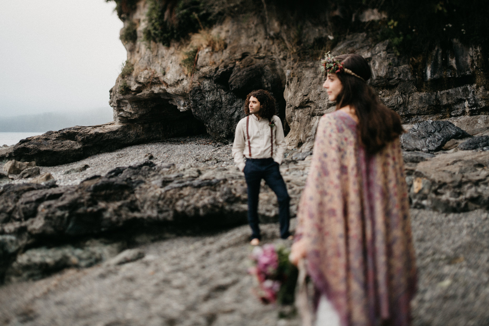 Couple looking towards the horizon Sombrio Beach Vancouver Island wedding
