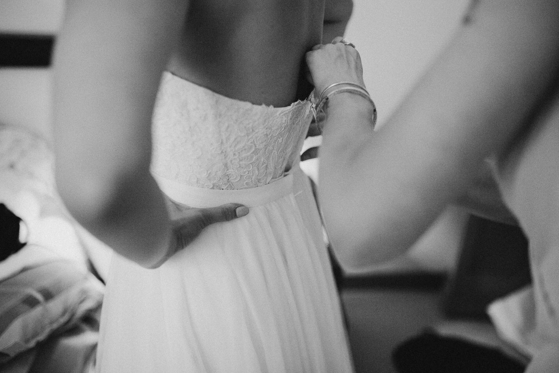 Final touches on the Bridal dress Galiano Inn Wedding