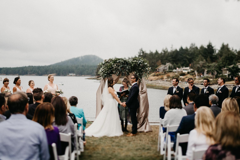 Bride and Groom holding each other Galiano Inn Beach Wedding Ceremony