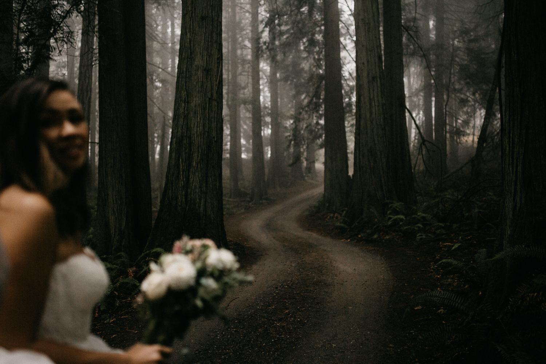 The Bride in a Foggy forest pathway Galiano Island Wedding