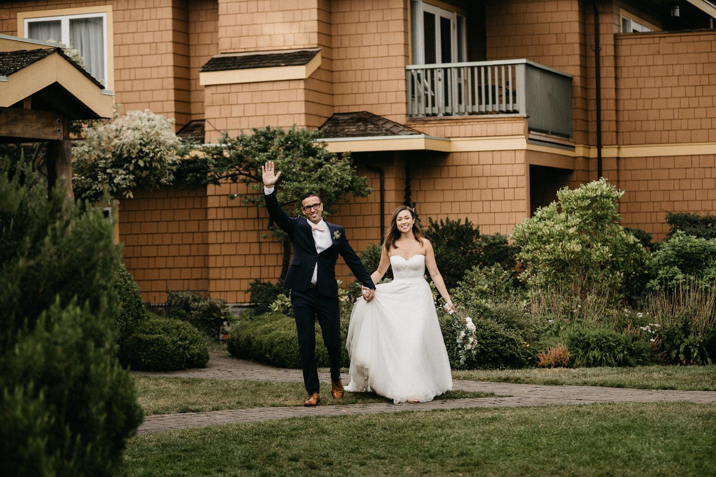 Newly wed couple bride and groom waiving Galiano Island Wedding