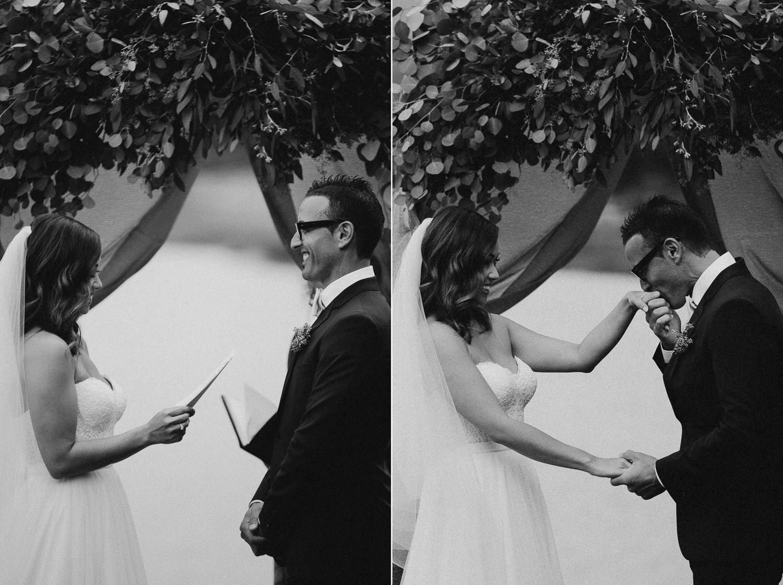 Groom kisses the Bride's hand Galiano Inn Beach Wedding Ceremony
