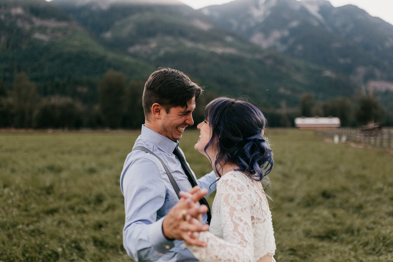Couple laughs in field at Pemberton farm wedding
