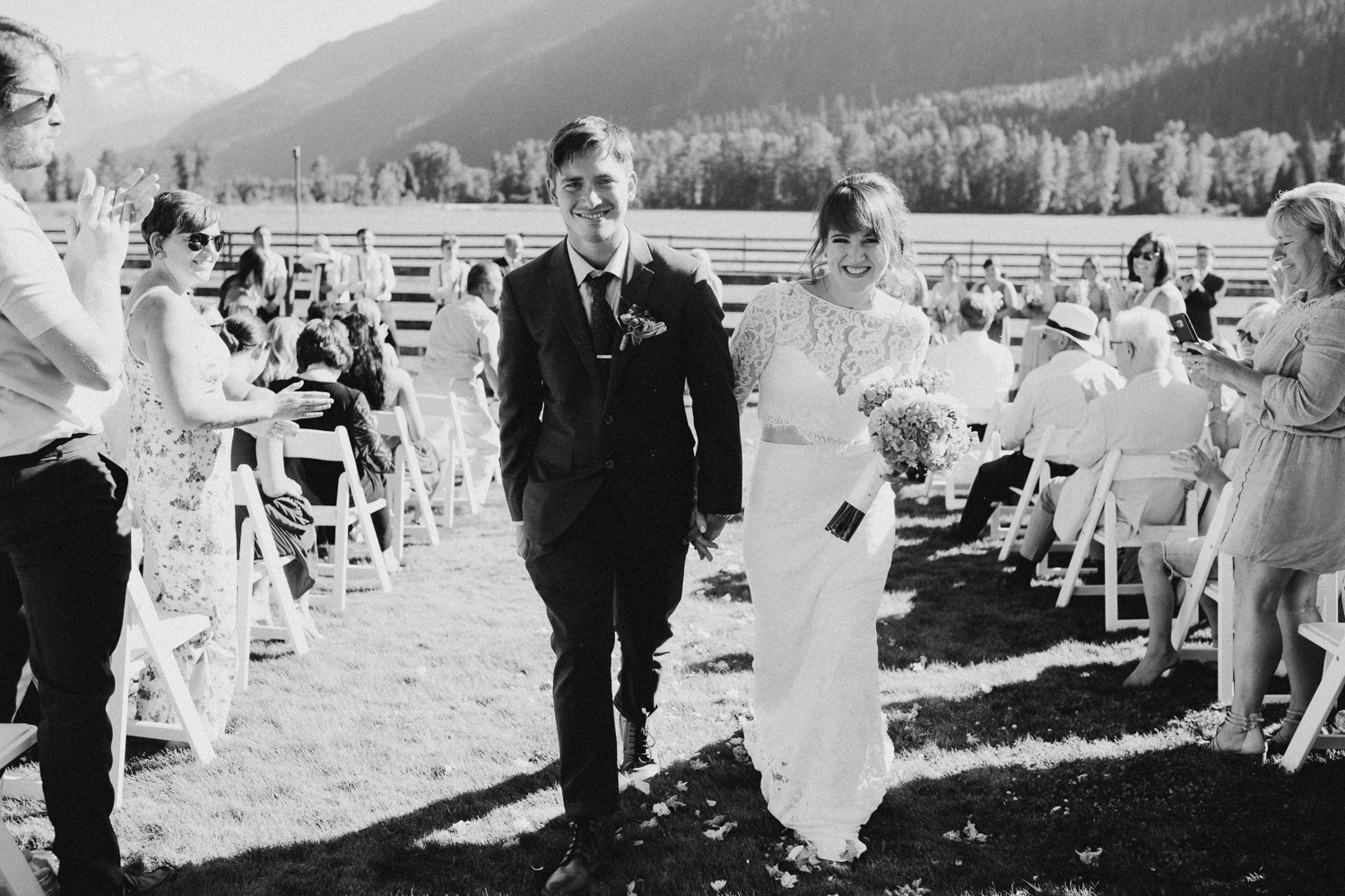 Couple walks down isle Pemberton Farm wedding