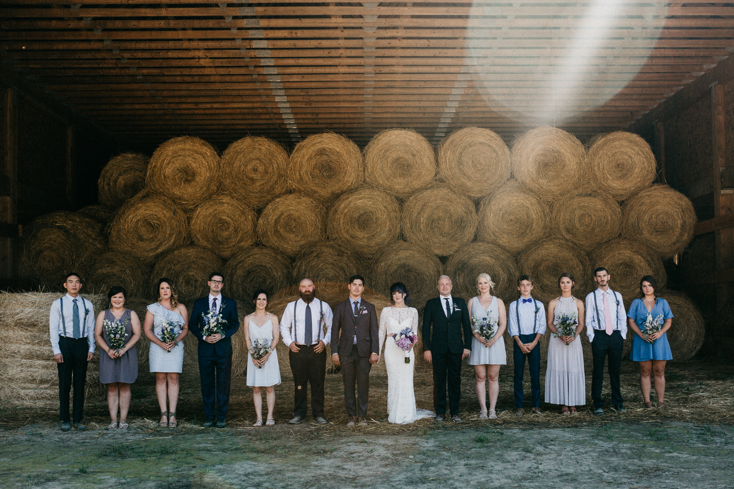 Bridal party in barn Pemberton Farm wedding