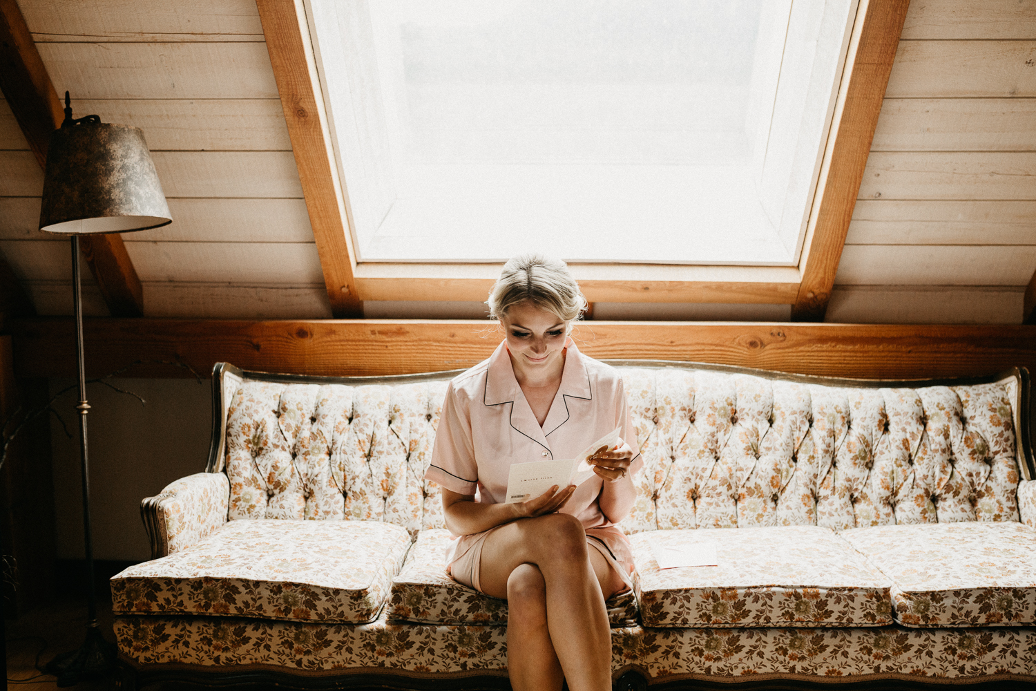 bride reading letter from groom at Bird's Eye Cove wedding, Vancouver Island wedding photographer