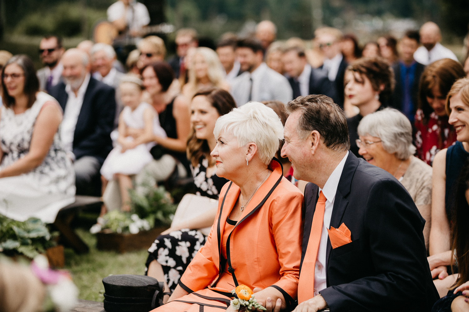 guests smiling at ceremony at Bird's Eye Cove wedding, Vancouver Island
