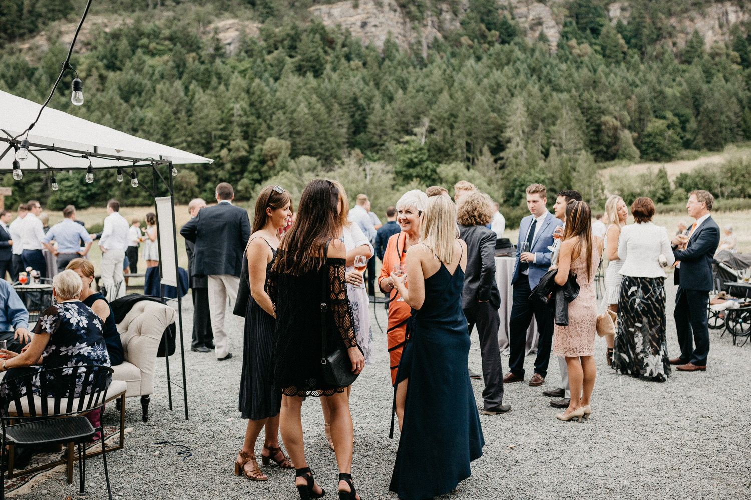 guests mingle at Bird's Eye Cove wedding, Vancouver Island