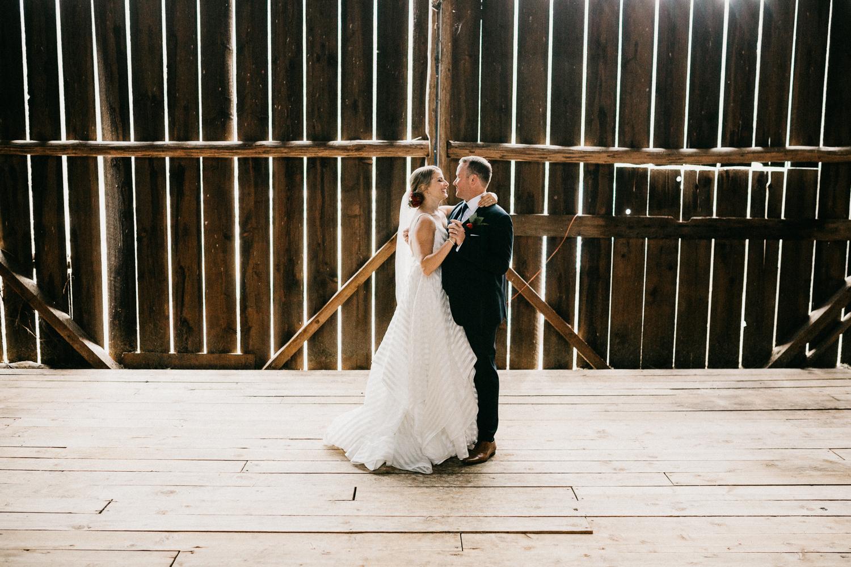 couple in barn at Bird's Eye Cove wedding, Vancouver Island