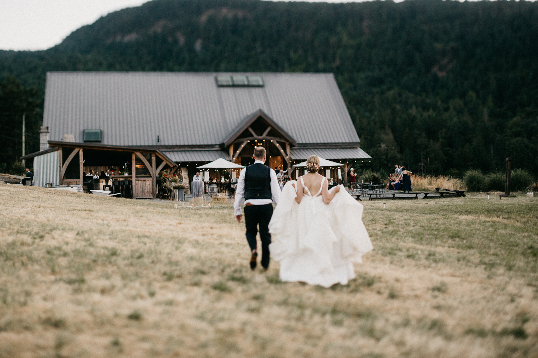 couple walks to reception at Bird's Eye Cove wedding, Vancouver Island