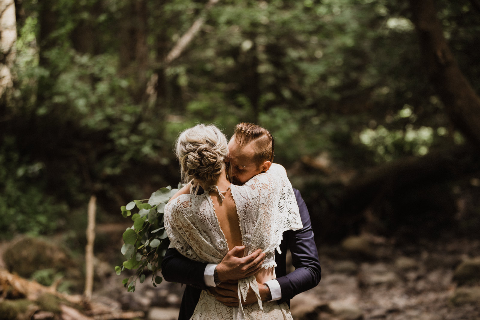 bride and groom embrace in forest victoria wedding photographer