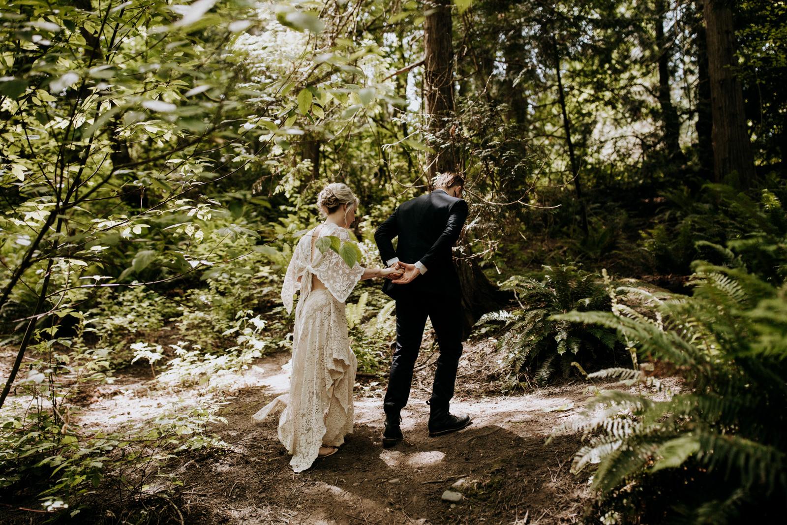 bride and groom walk through forest victoria wedding photographer