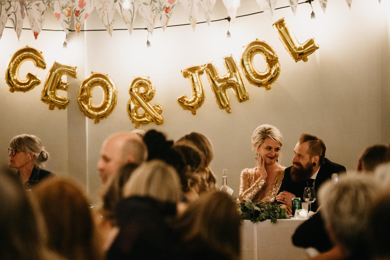 couple at their wedding reception victoria wedding photographer